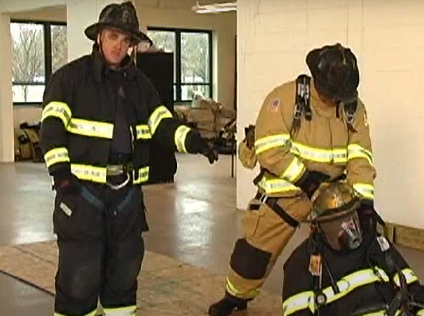 Dan DiRenzo and firefighter performing a rescue drag using firefighter PPE