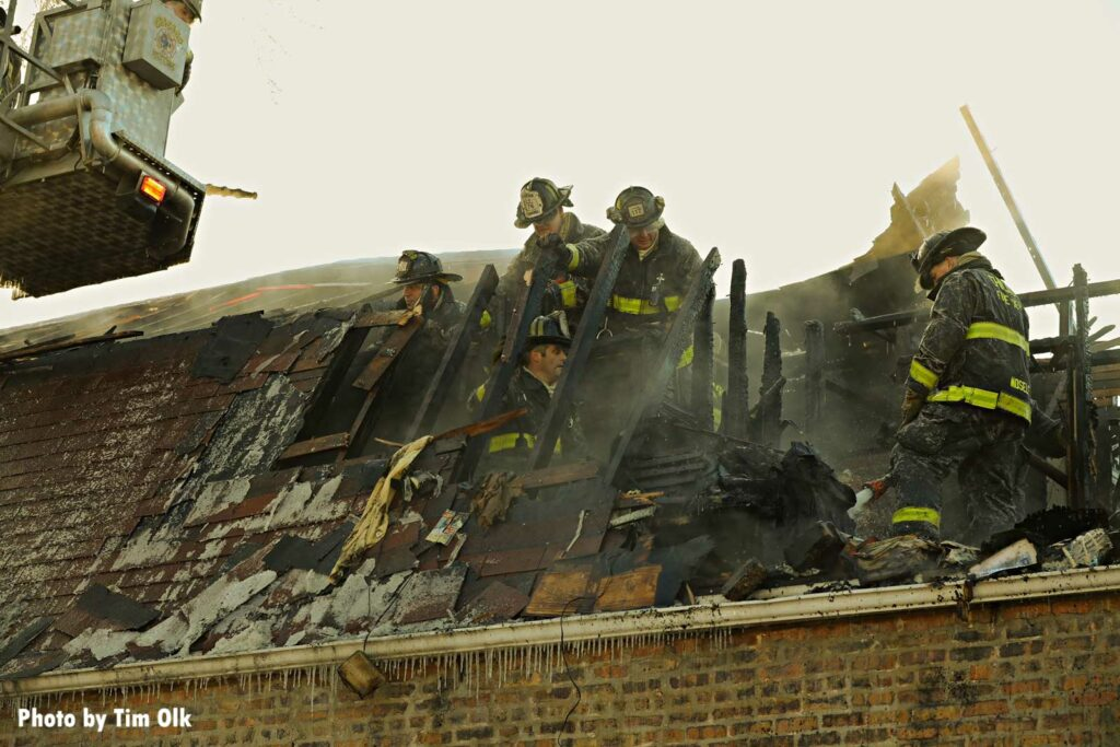 Chicago firefighters on the roof during a structure fire