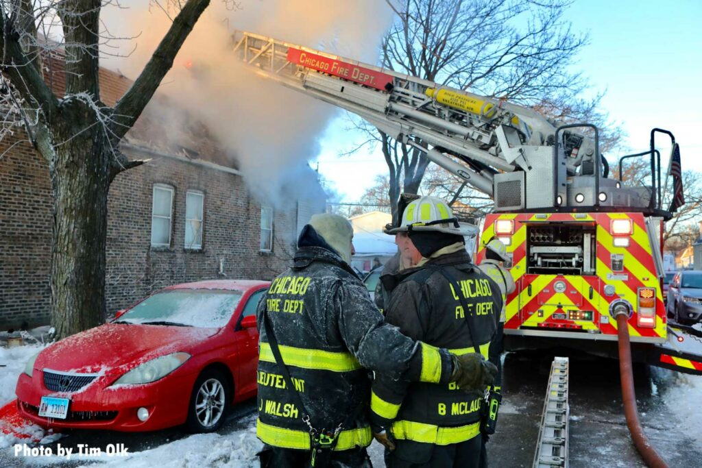 Chicago firefighters operating in extreme cold temperatures during a house fire