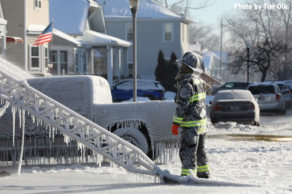 Icicles and a firefighter at the scene of the fire