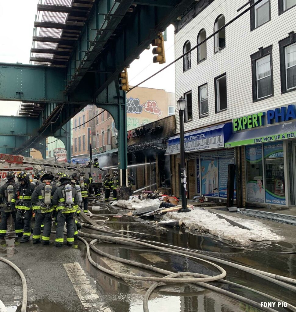 FDNY firefighters and hoselines at major Queens fire