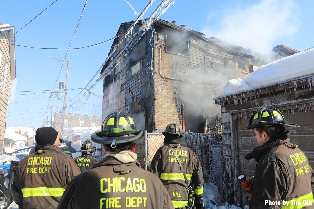 Multiple firefighters at the scene of a Chicago fire with Mayday