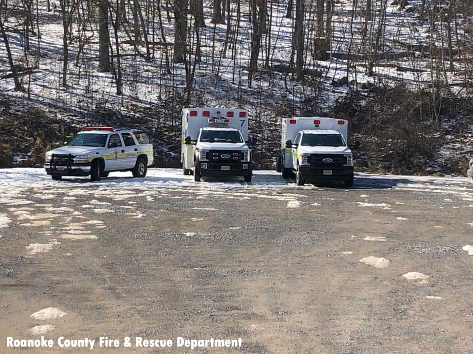 Ambulances and official vehicles at scene of rescue