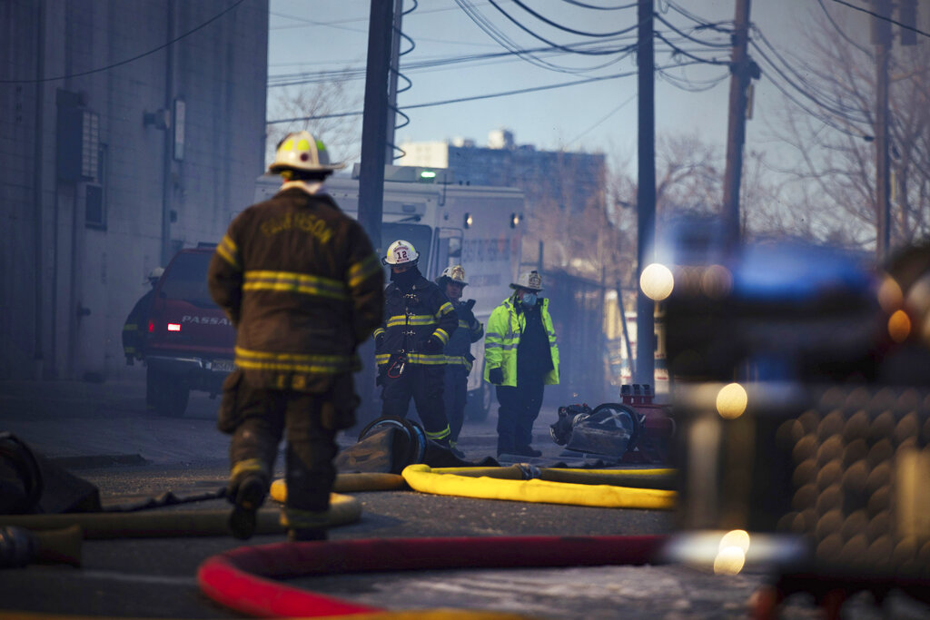 Firefighters at the scene of a major recycling center fire in Passaic, New Jersey