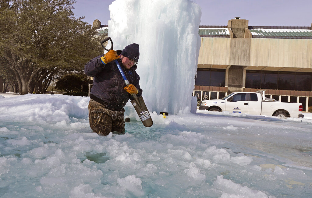 Man digs through ice and snow in Texas
