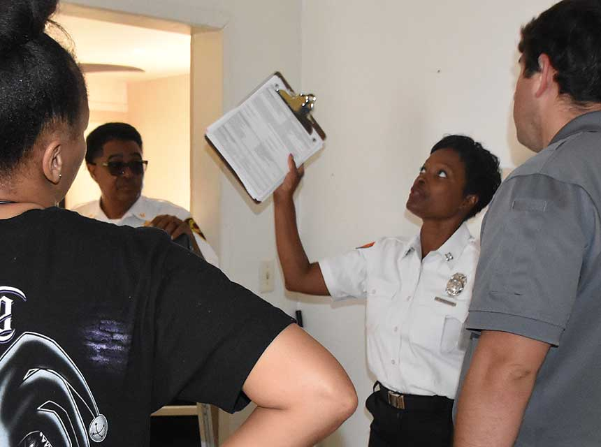 Fire marshal advising residents on fire safety