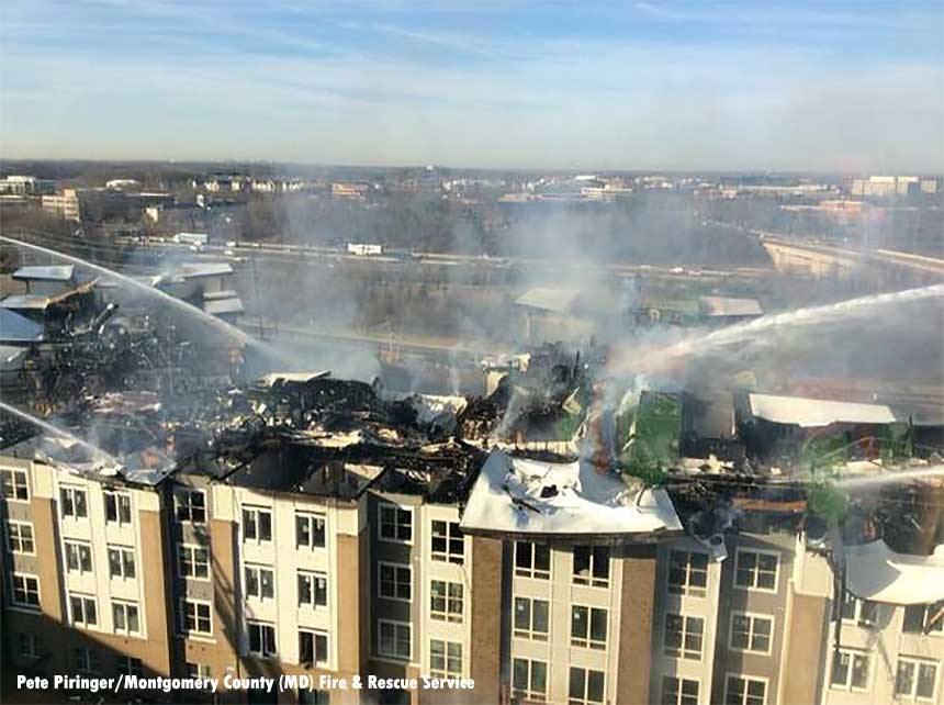 Firefighters use multiple elevated streams during a fire in Rockville, Maryland.
