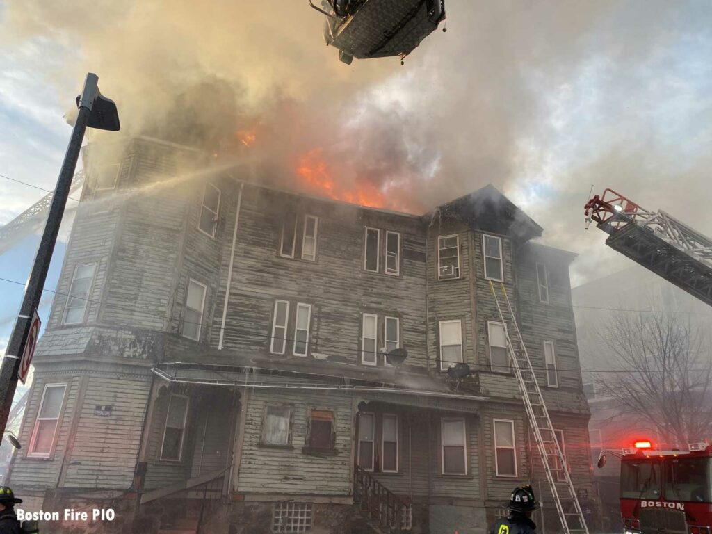 Flames rip through the building as Boston firefighters attack the fire from the exterior