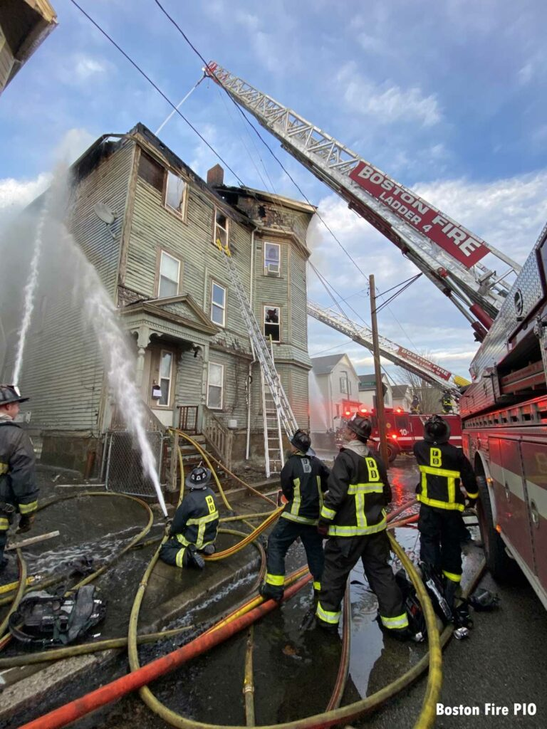 Boston aerial ladder putting water on fire building