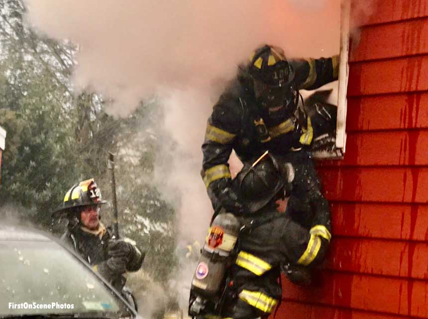 Firefighter emerges from window at Long Island house fire