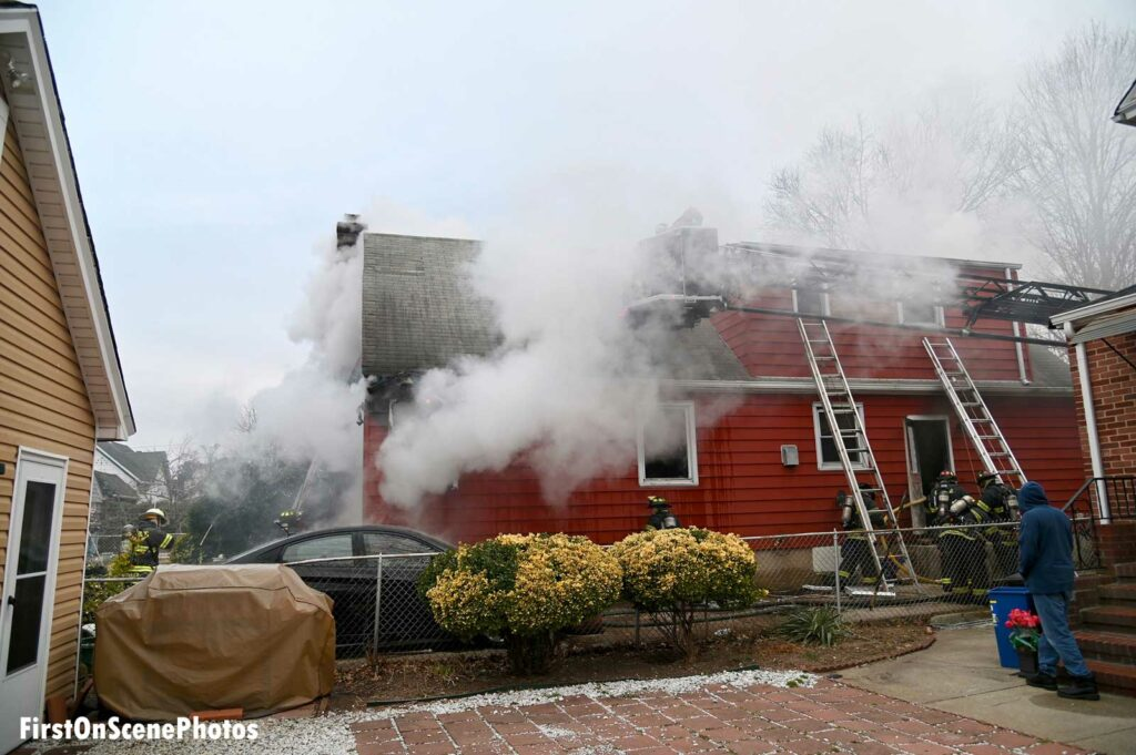 Flames and smoke shoot from a home on Long Island