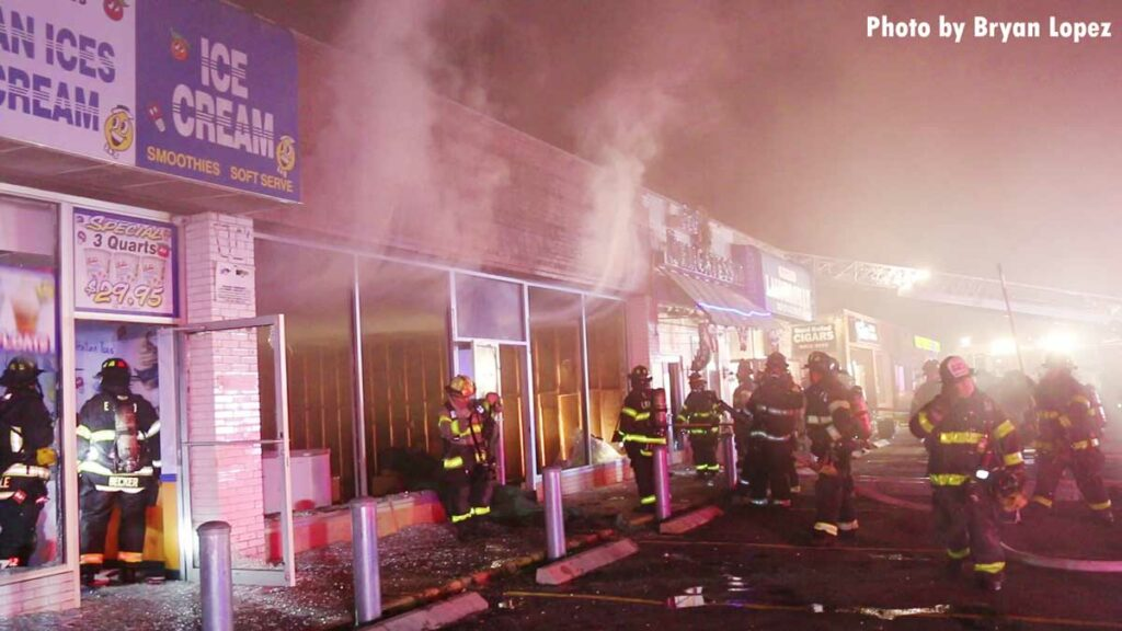 Smoke from storefront at commercial fire on Long Island