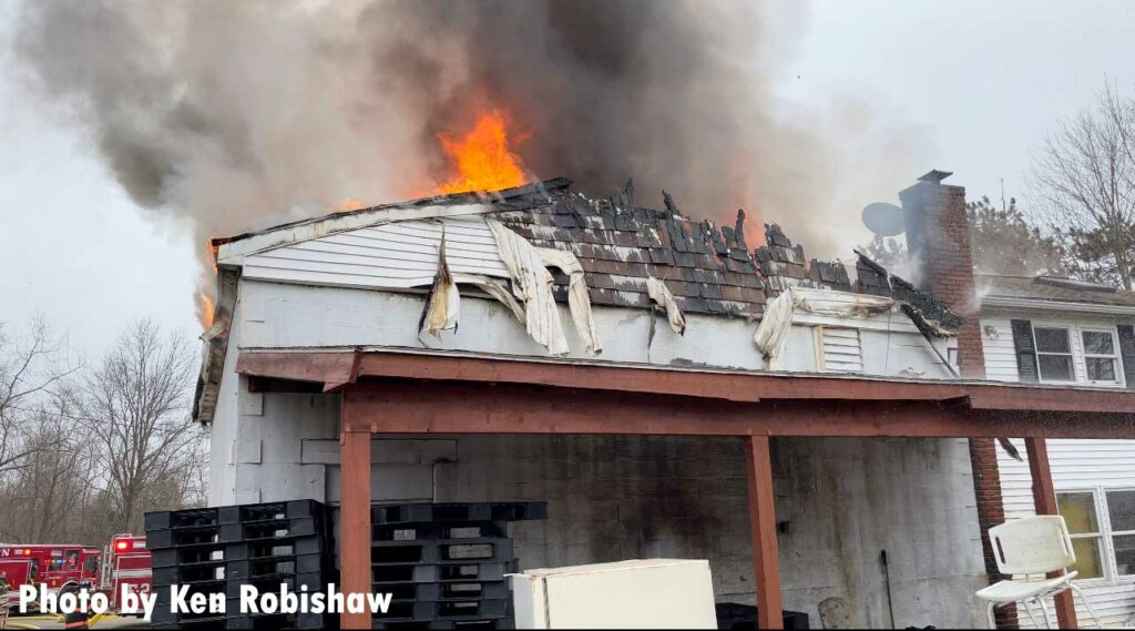 Flames rip along the roof of the building