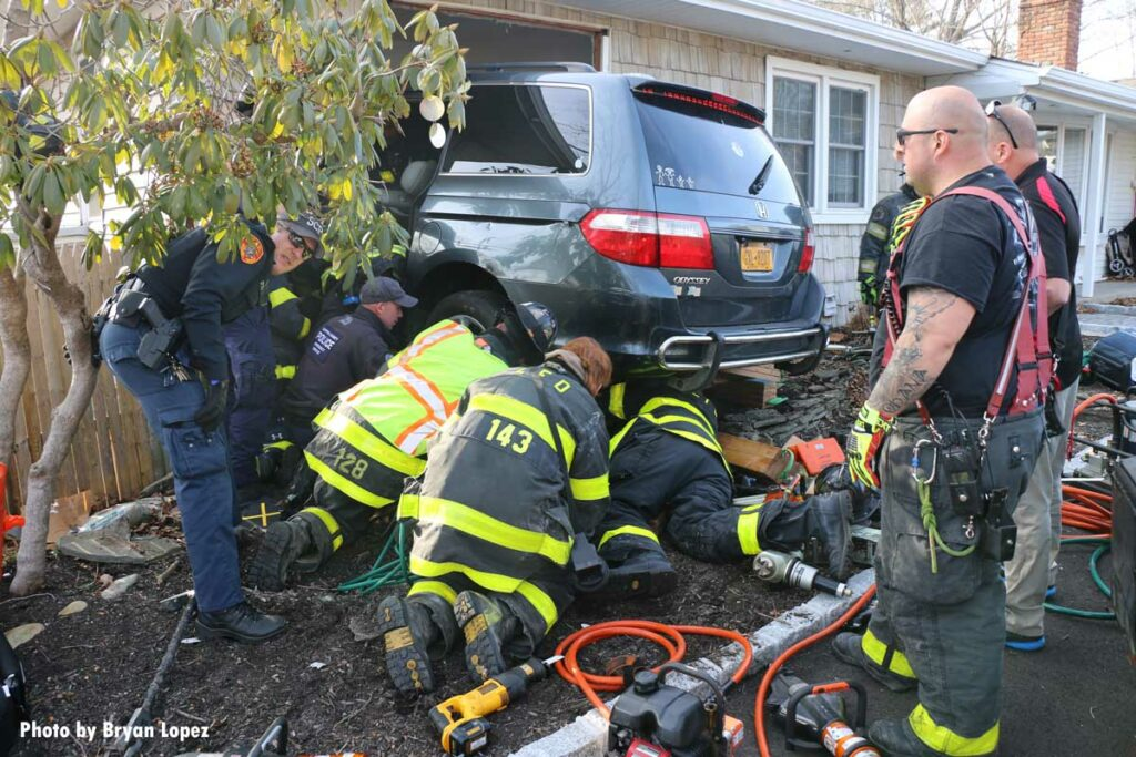 Firefighters respond to car into home on Long Island