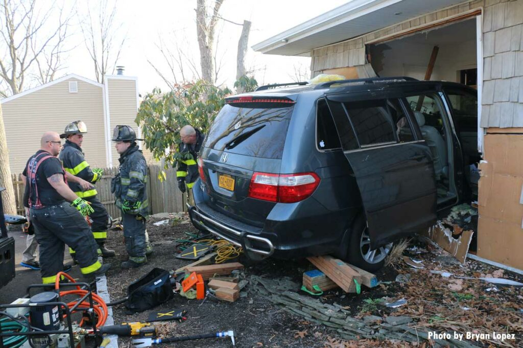 Firefighters perform extrication of car that barreled into home on Long Island
