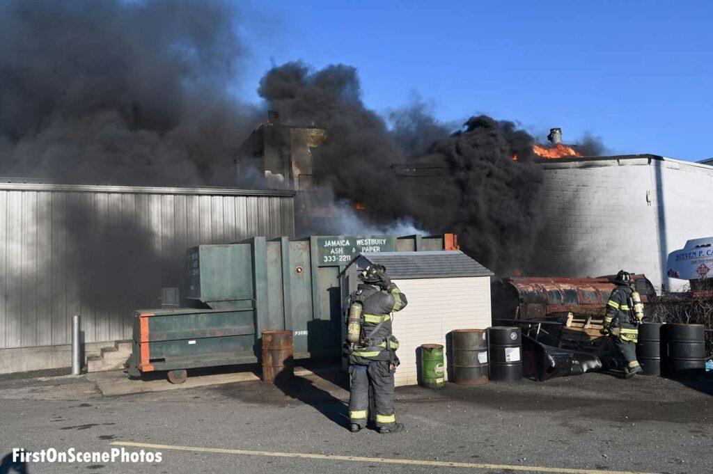 Heavy black smoke shoots from a building in Hempstead, Long Island.