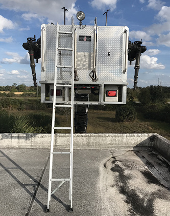 When encountering a high parapet, firefighters can deploy the folding ladder from a tower ladder bucket or off the tip of an aerial ladder for roof access.