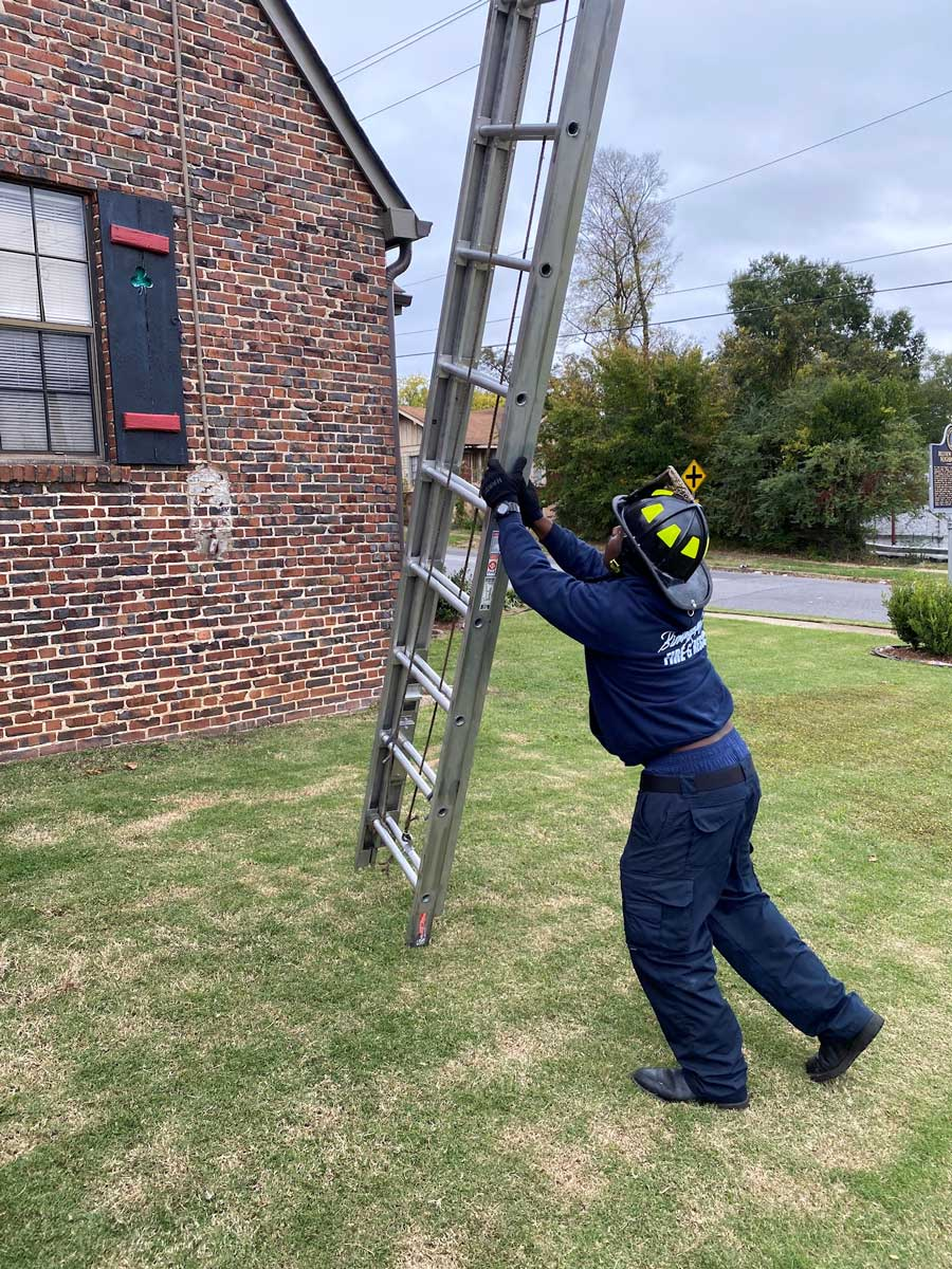 Firefighter training on a ground ladder