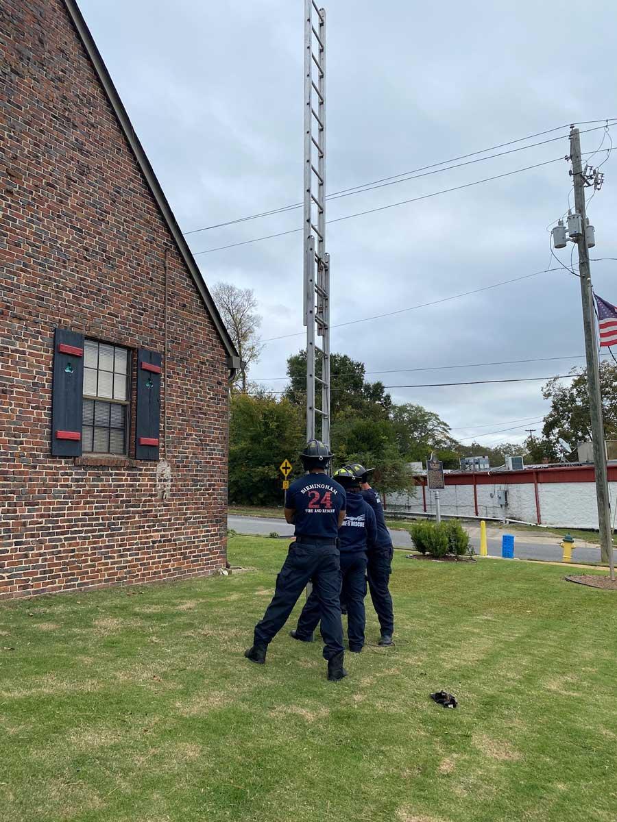 Firefighters raising a ladder