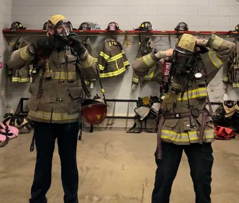 Firefighters masking up in station