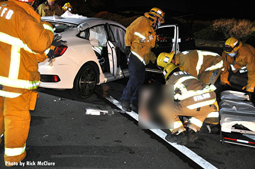 LAFD firefighters remove a victim from a crash scene