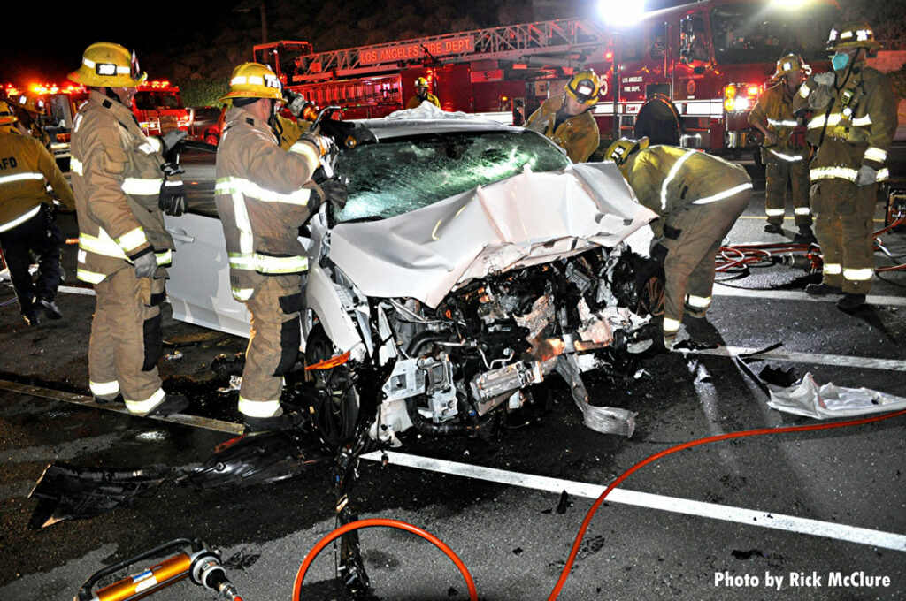 Firefighters attempt to access victim during motor vehicle accident in Los Angeles