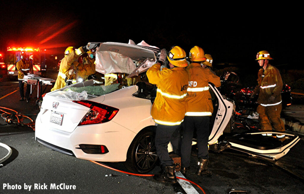 LAFD firefighters remove roof of vehicle