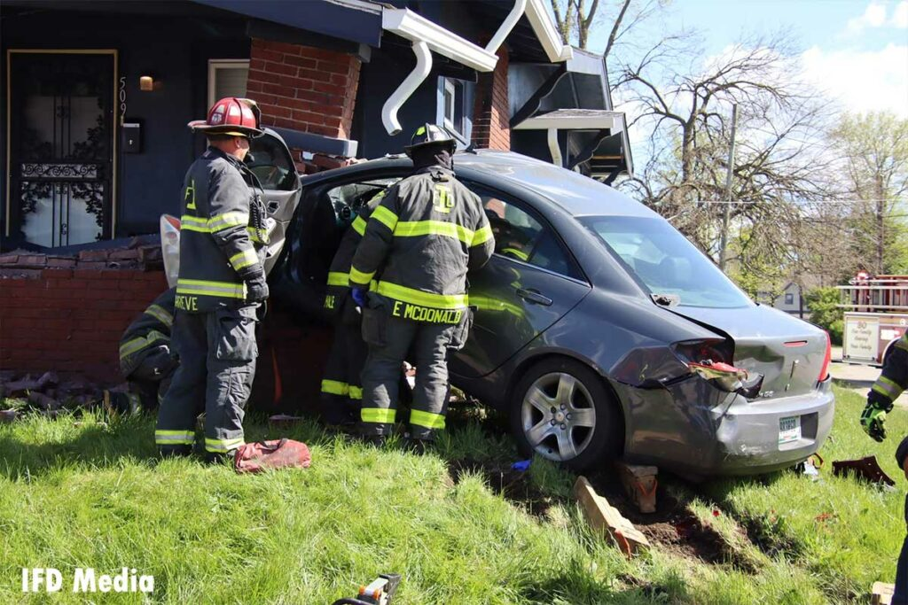 Indianapolis firefighters respond to car into a home