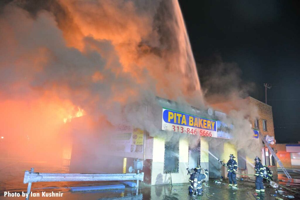 Firefighters use multiple exterior streams on the commercial fire