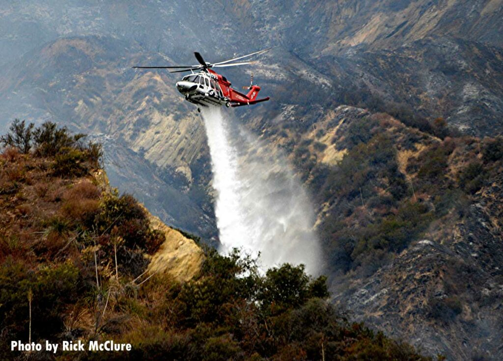 Helicopter makes retardant drop on Palisades File outside Los Angeles