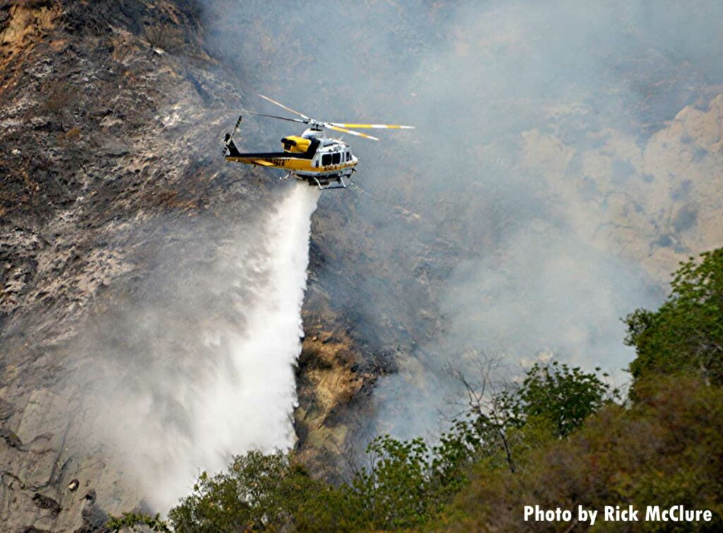 Helicopter makes a drop on the Palisades Fire