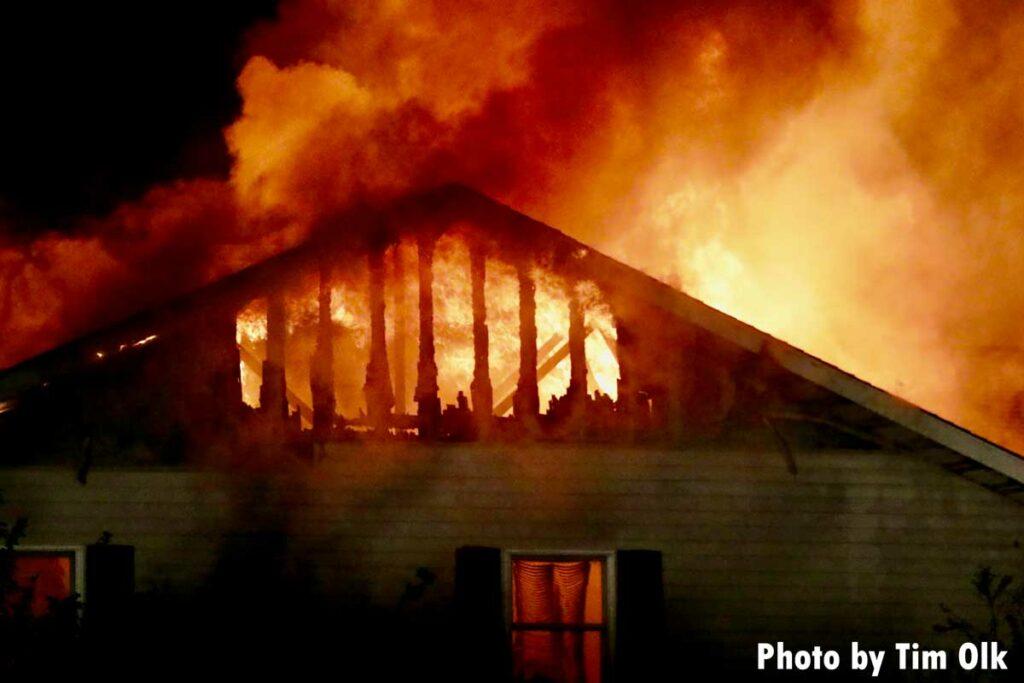 Flames tear through top of home in Danville, Iowa