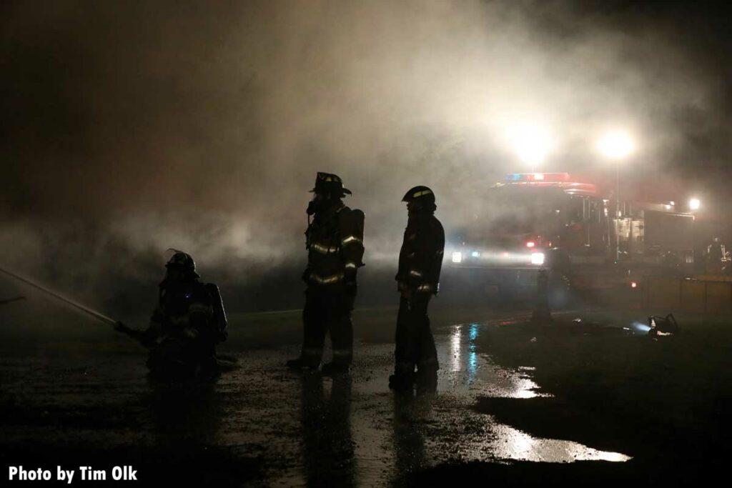 Firefighters in smoke at scene of fire in Danville, Iowa