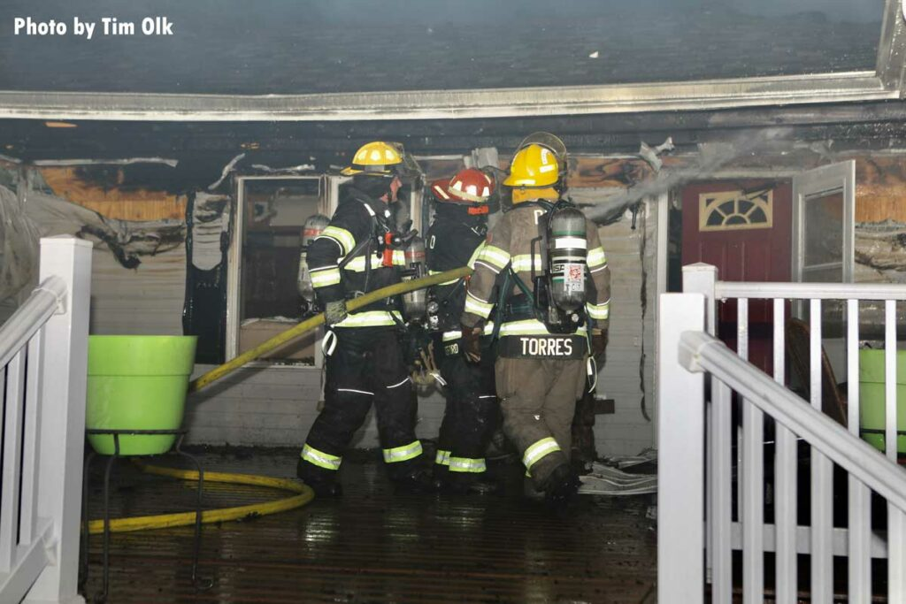 Firefighters put water under roofline at Iowa fire