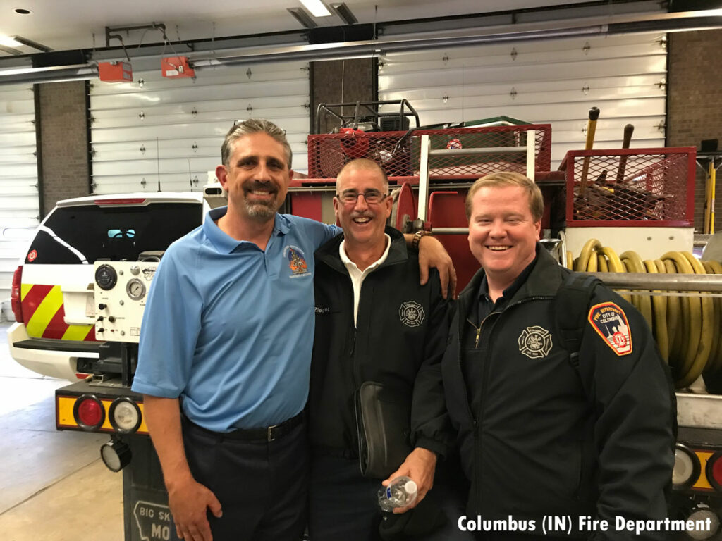 Columbus firefighters with Chief Anthony Kastros, at left