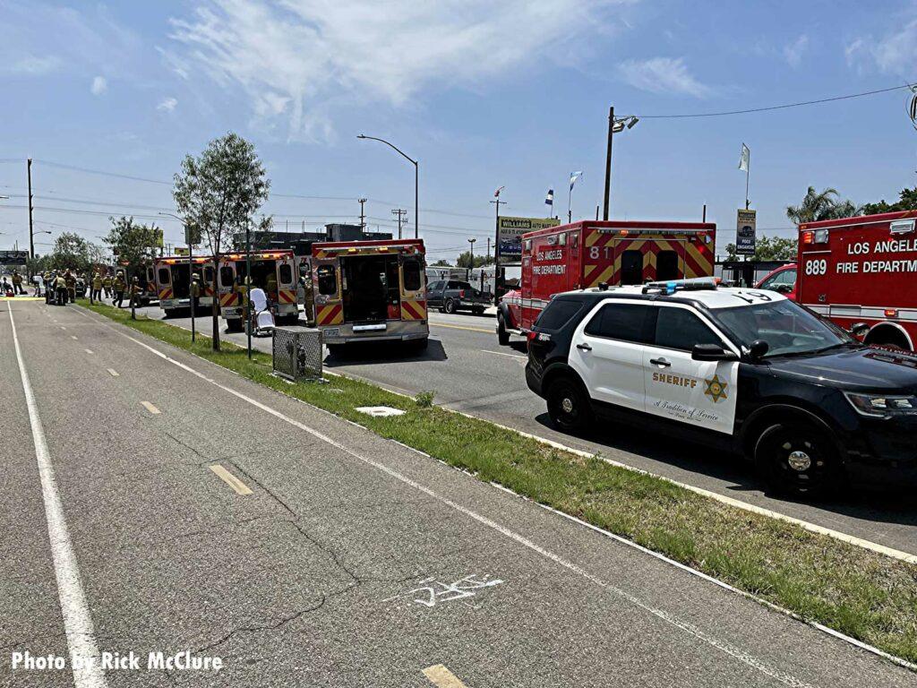 A sheriff's vehicle along with multiple LAFD ambulances