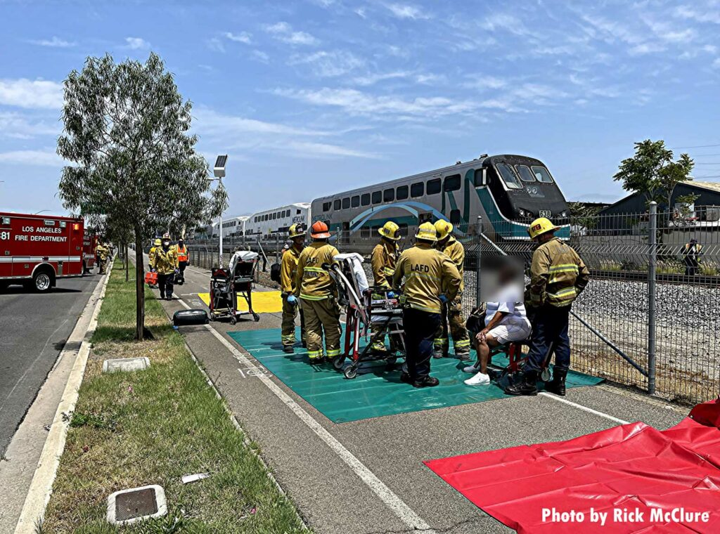 Firefighters assist a patient after Los Angeles train incident
