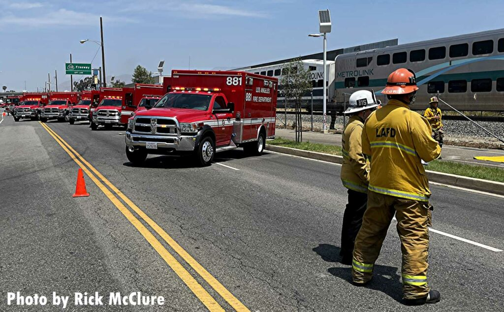 LAFD firefighters stand near ambulances staged at scene of rail incident