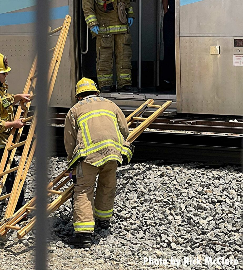 Firefighters employ ladders at rail incident in Los Angeles