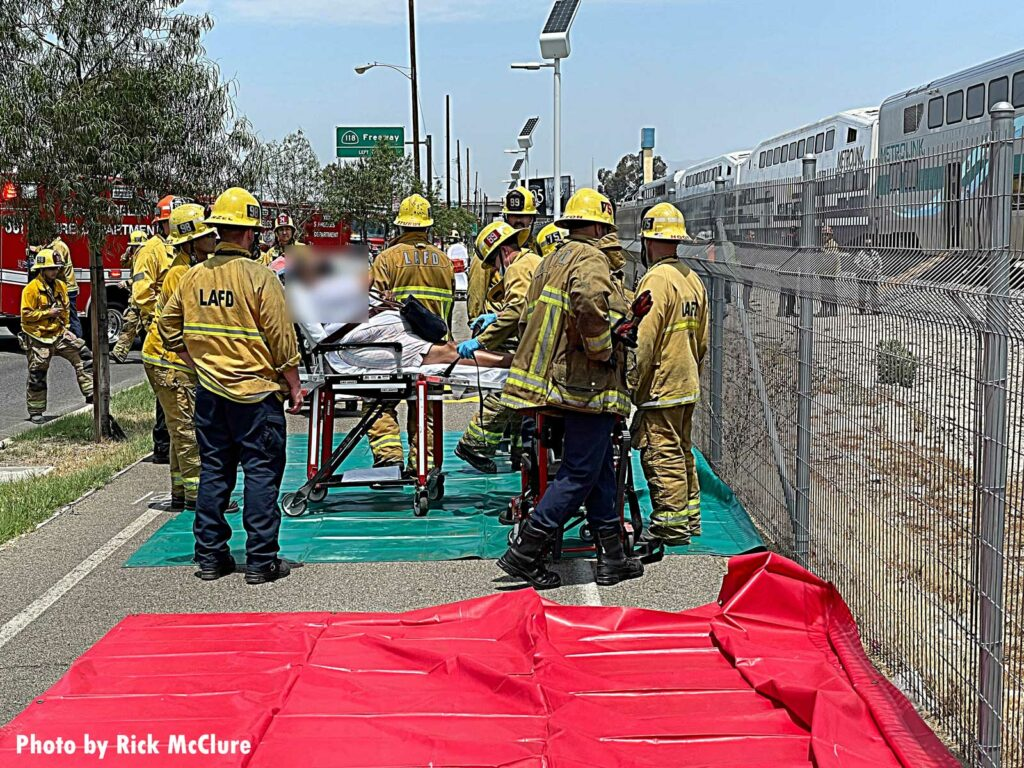 LAFD firefighter load patient onto stretcher