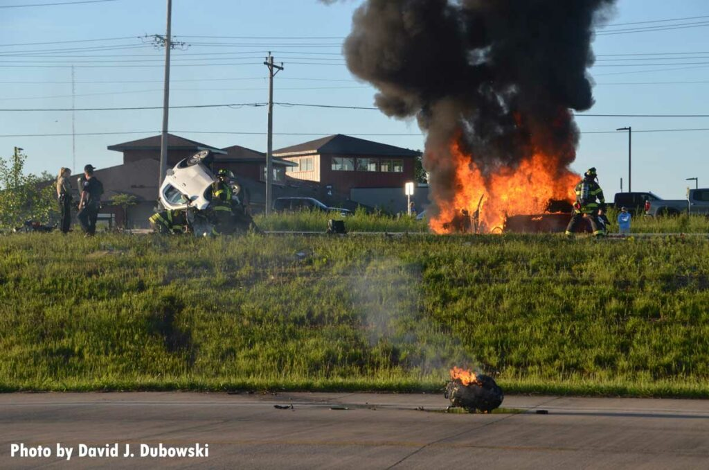 Massive flames and smoke at the scene of a vehicle incident