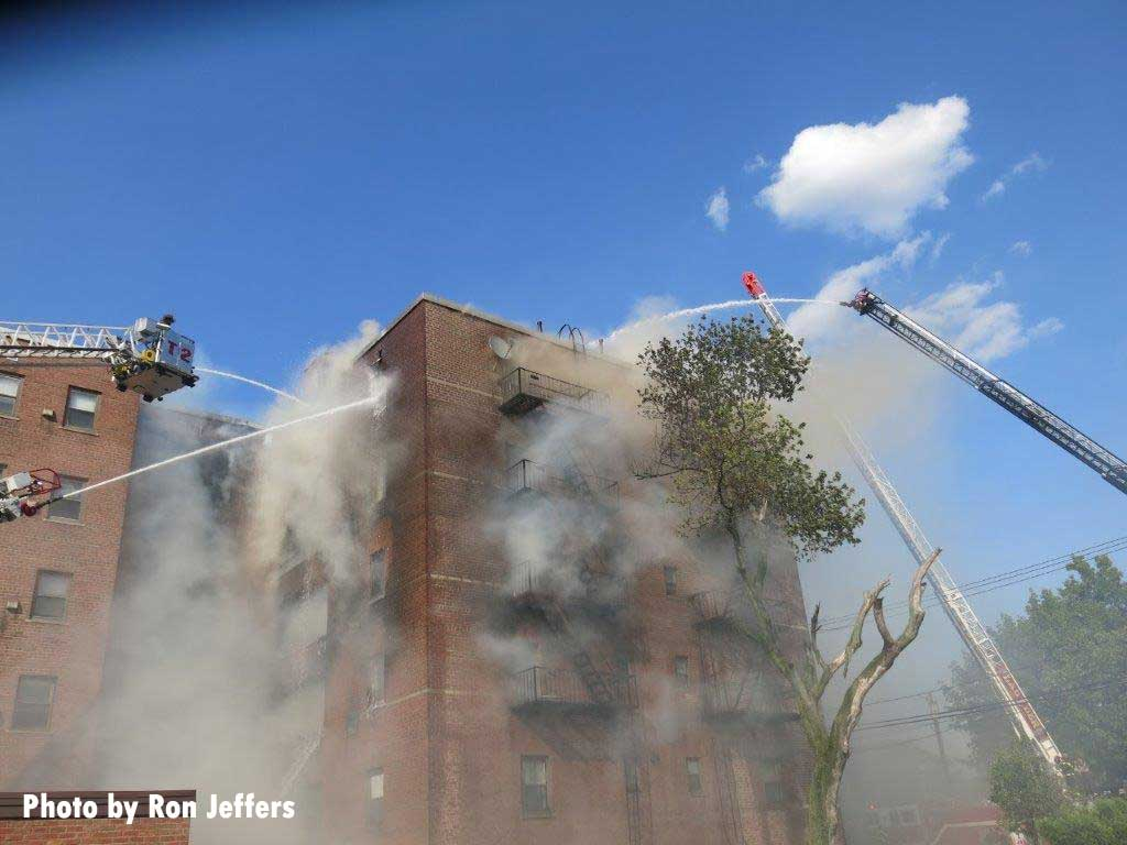 Tower ladder and aerial ladder master streams put on fire building in Fort lee