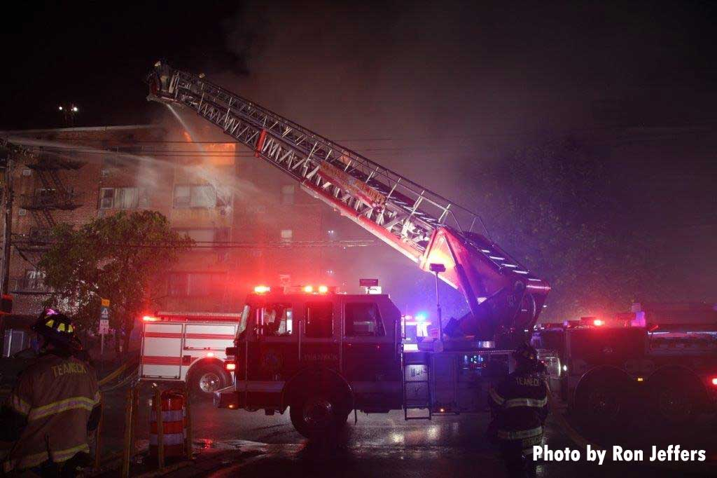 Tower ladder flowing water at Fort Lee fire