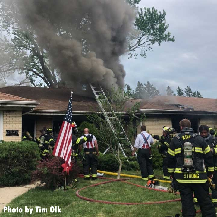 Firefighters at a house fire with hoarding in Lincolnwood