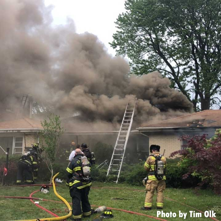 Ladder thrown at house as smoke envelops the building