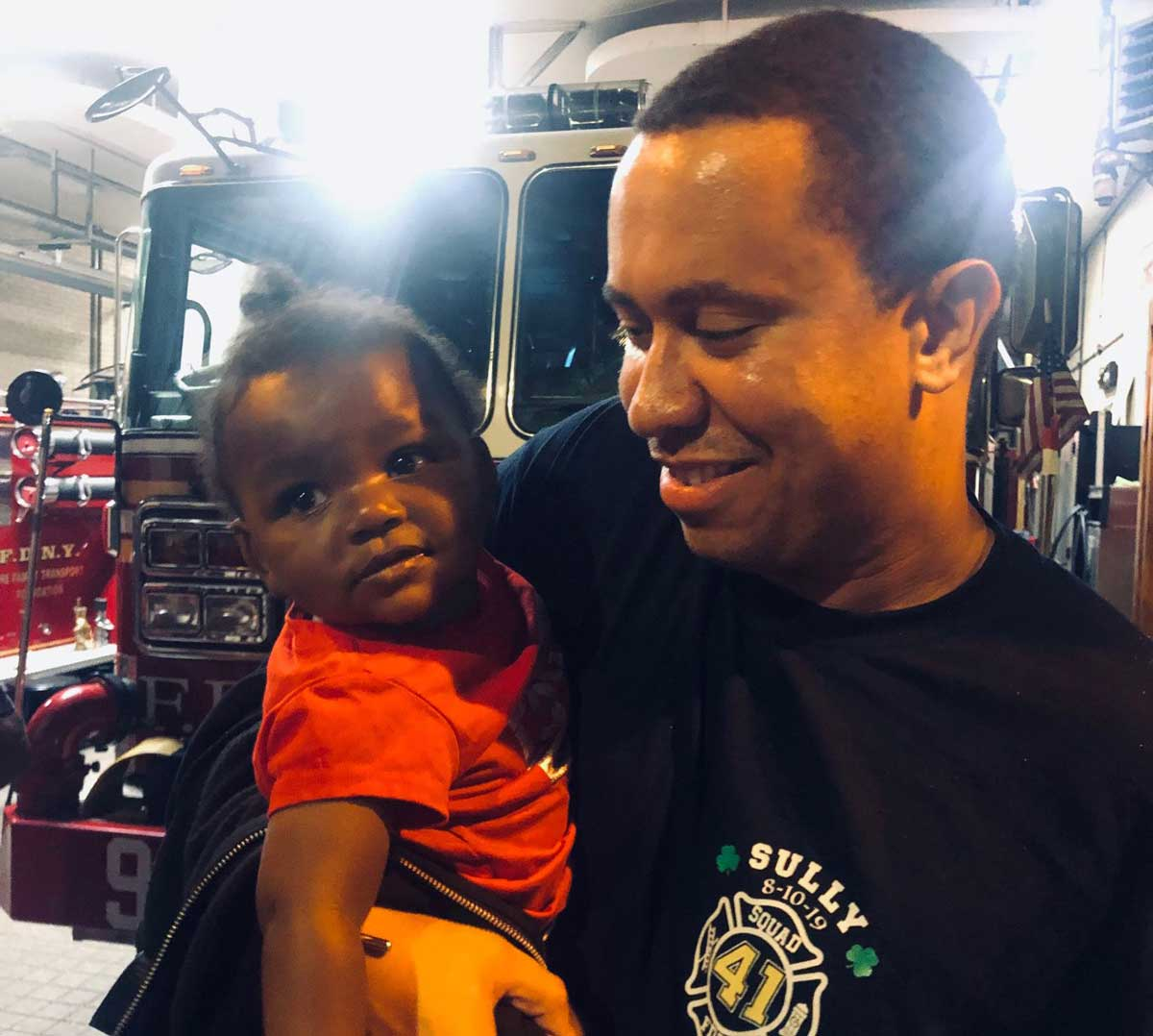 Mi Angel Gaines with a member of FDNY Engine 41