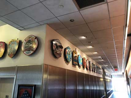 Company patches line the hallways at the Rock