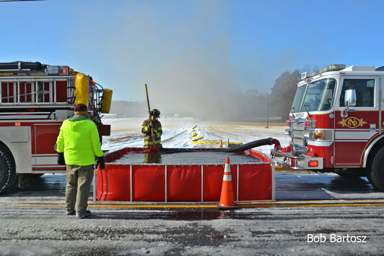 Firefighters with dump tank