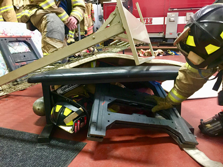 Down firefighter covered in debris