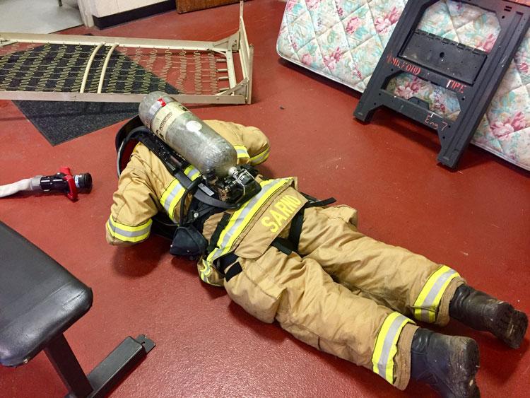 Firefighters perform rapid intervention team training